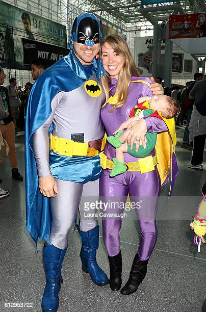 Cosplayers Jon Greer Ashley Greer and son Grayson Greer dressed as Batman Batgirl and Robin attend 2016 New York Comic Con Day 1 on October 6 2016 in...