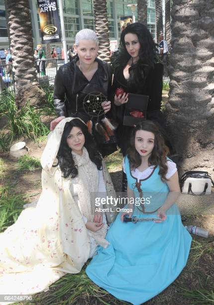 Cosplayers Julie Carter as Dark Swan Cathy Kutz as The Dark Queen and Sarah Francis Clingenpeel as Belle from 'Once Upon A Time' on Day 3 of...