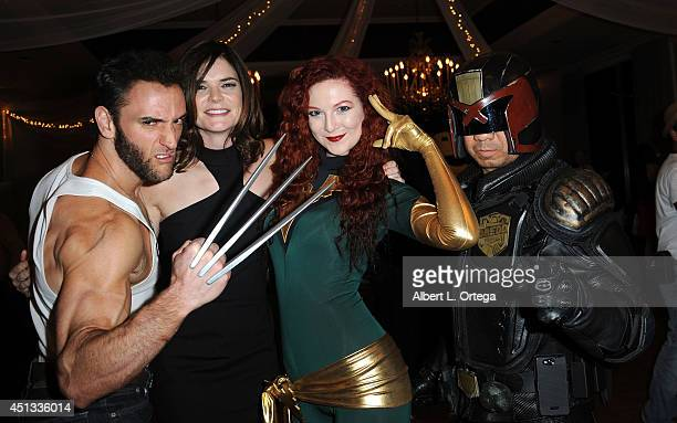 Cosplayers Lon Brown as Wolverine actress Betsy Brandt Ashlynne Dae as Phoenix and Michael Baricante as Judge Dredd attend the After Party for the...