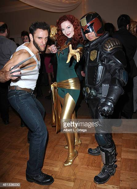 Cosplayers Lon Brown as Wolverine Ashlynne Dae as Phoenix and Michael Baricante as Judge Dredd attend the After Party for the 40th Annual Saturn...