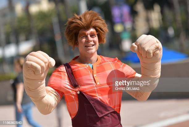Cosplayers make their way to the Convention Center during Comic Con in San Diego, California on July 18, 2019.