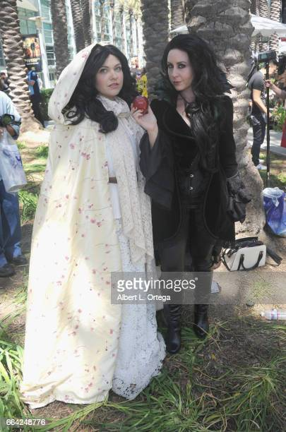 Cosplayers Malerie McDonald as Snow White and Cathy Kutz as The Evil Queen from 'Once Upon A Time' on Day 3 of WonderCon 2017 held at Anaheim...