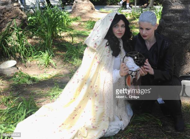Cosplayers Malerie McDonald as Snow White and Julie Carter as Dark Swan from 'Once Upon A Time' on Day 3 of WonderCon 2017 held at Anaheim Convention...