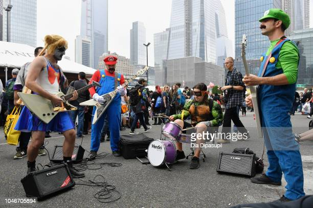 Cosplayers peform outside during New York Comic Con at Jacob Javits Center on October 6 2018 in New York City
