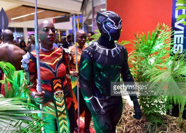 Cosplayers portraying characters from the 2018 US superhero film based on the Marvel Comics character 'The Black Panther' pose in the Kenyan capital...