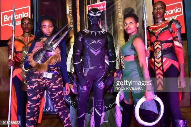 Cosplayers portraying characters from the 2018 US superhero film based on the Marvel Comics character, 'The Black Panther' pose in the Kenyan...