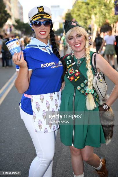 """Cosplayers portraying Robin Scoops Ahoy from """"Stranger Things"""" and a girl scout attend the 2019 Comic-Con International on July 18, 2019 in San..."""