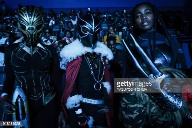Cosplayers pose before watching the film 'Black Panther' featuring Oscar winning Kenyan actress Lupita Nyong'o during Movie Jabbers Black Panther...