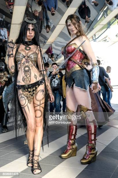 Cosplayers pose during a cosplay contest at the Romics event a comic book and gaming convention on October 7 2017 in Rome Romics is the largest...