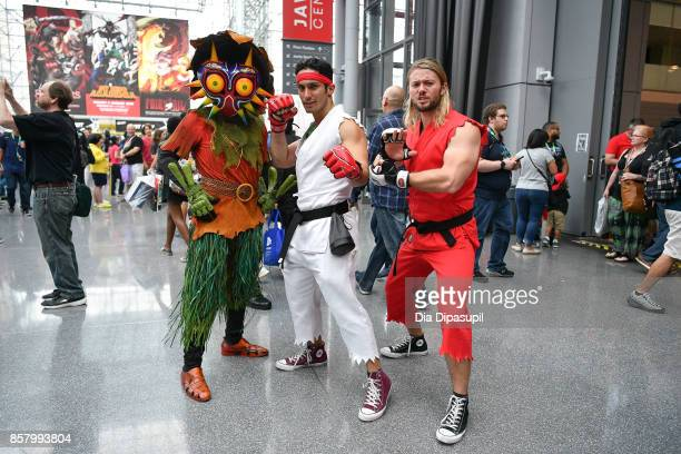 Cosplayers pose during New York Comic Con 2017 at Javits Center on October 5 2017 in New York City