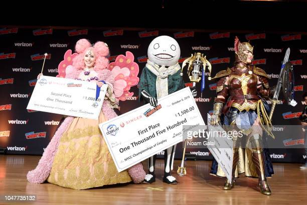 Cosplayers pose during New York Comic Con 2018 at Javits Center on October 6 2018 in New York City