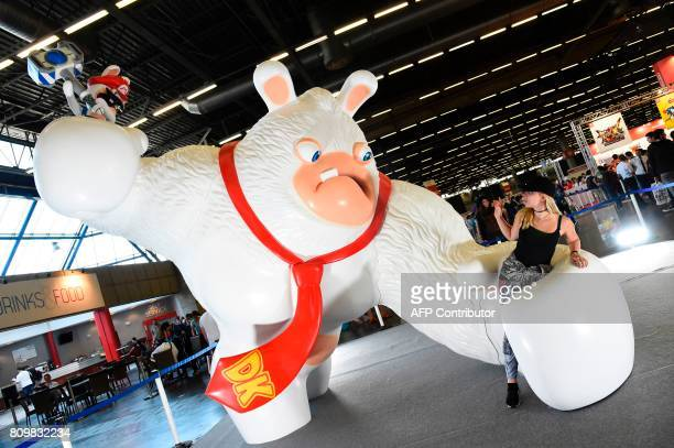 Cosplayers pose during the 2017 Japan Expo exhibition on July 6, 2017 in Villepinte, near Paris. The 2017 Japan Expo, dedicated to Japanese culture...