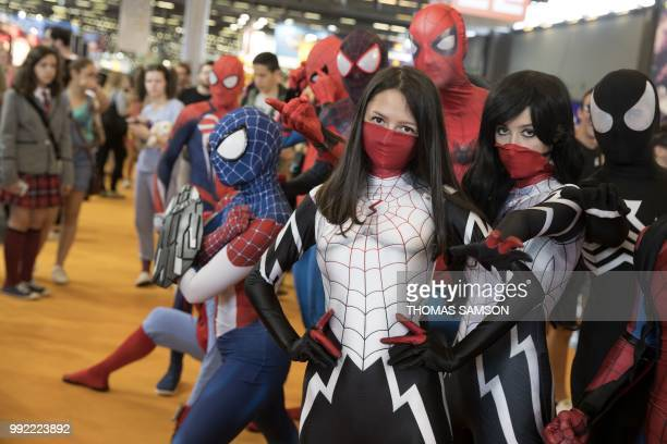 Cosplayers pose during the 2018 Japan Expo exhibition on July 5, 2018 in Villepinte, near Paris.