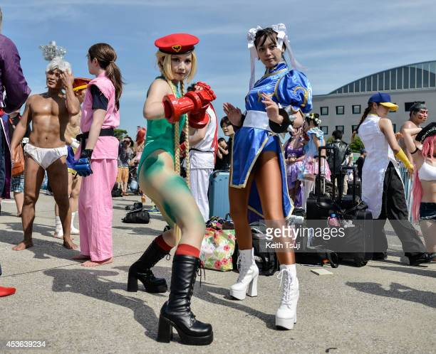 Cosplayers pose during the Comic Market 86 at Tokyo Big Sight on August 15 2014 in Tokyo Japan