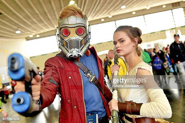 Cosplayers pose during the German Comic Con at Westfallenhallen on December 3 2016 in Dortmund Germany