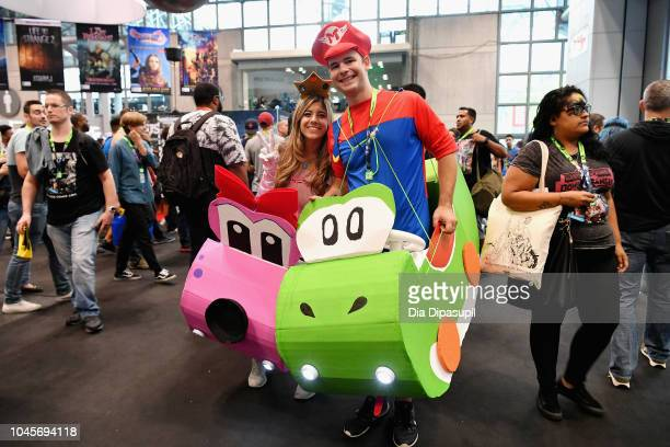 Cosplayers pose for a photo during New York Comic Con 2018 at Jacob K Javits Convention Center on October 4 2018 in New York City