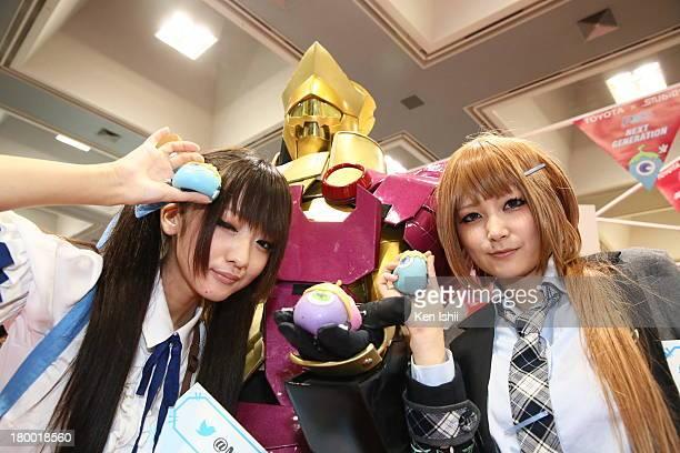 Cosplayers pose for photo during Kyoto International Manga Anime Fair 2013 at Miyako Messe on September 8 2013 in Kyoto Japan