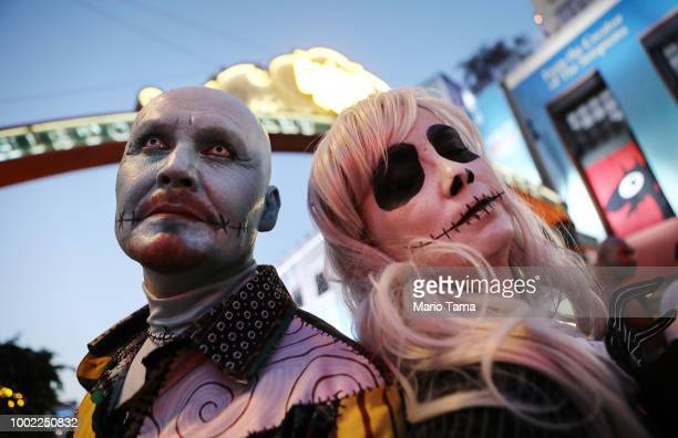 Cosplayers pose on the street outside San Diego ComicCon on July 19 2018 in San Diego California Thousands of revelers are arriving for the...