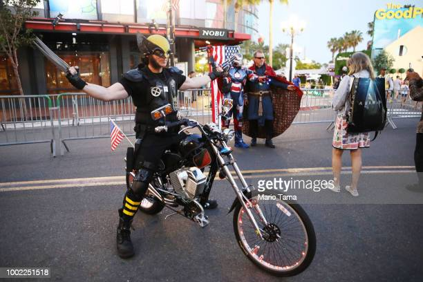 Cosplayers pose outside San Diego ComicCon on July 19 2018 in San Diego California Thousands of revelers are arriving for the festivities at the...