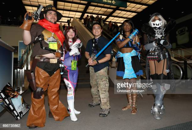 Cosplayers pose together for a photograph during the Electronic Entertainment Expo E3 at the Los Angeles Convention Center on June 13 2017 in Los...