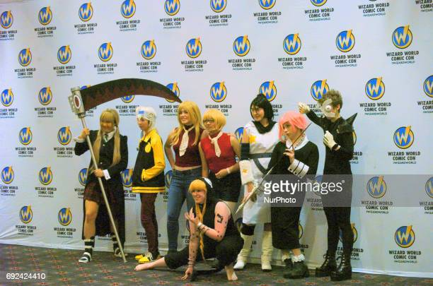 Cosplayers pose with the Wizard World Back Drop at Wizard World Philadelphia on June 4 2017