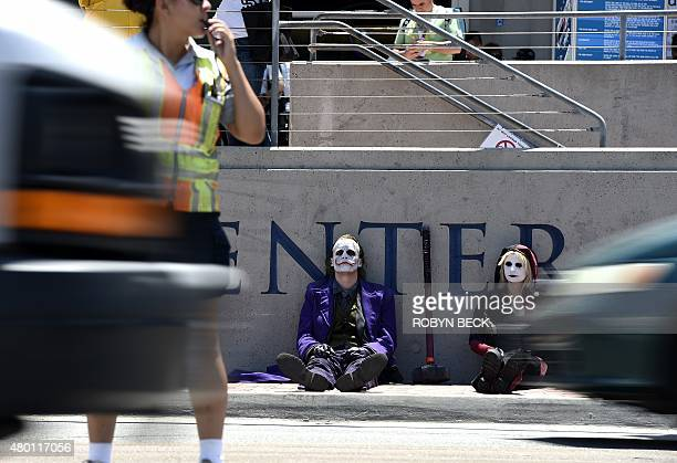 Cosplayers take a break on the first day of Comic Con International in San Diego, California, July 9, 2015. AFP PHOTO / ROBYN BECK