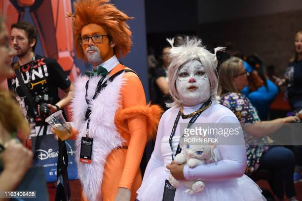 Cosplayers visit the D23 Expo billed as the largest Disney fan event in the world August 23 2019 at the Anaheim Convention Center in Anaheim...