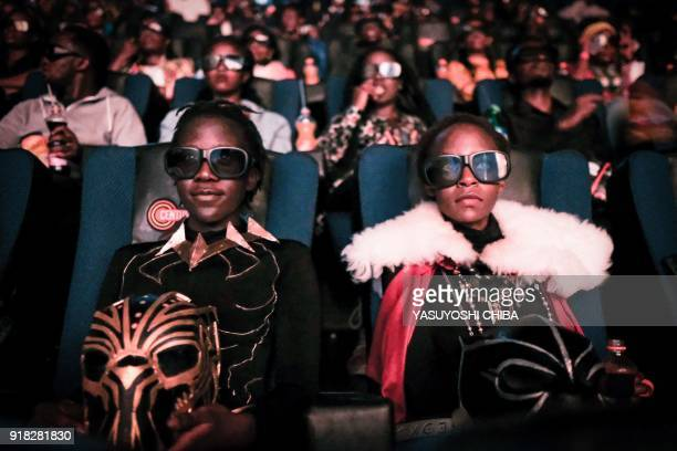 Cosplayers watches the film Black Panther in 3D which featuring Oscarwinning Mexico born Kenyan actress Lupita Nyongo during Movie Jabbers Black...