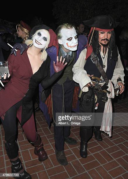 Cosplayers Zoe Garcia as Harley Quinn Jesse Oliva as The Joker from 'The Dark Knight' and Ethan Jason as Captain Jack Sparrow attend the 41st Annual...