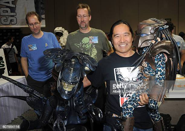 Cosplayers Zoe Miyamoto R2 builder William Miyamoto and Kayla Miyamoto as Alien Queen and Predator attend the Long Beach Comic Con held at Long Beach...
