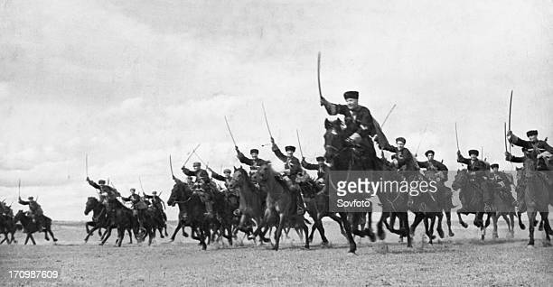 A cossack cavalry unit charging with sabres drawn on the crimean front may 1942