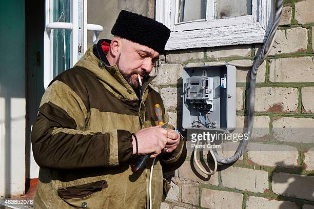 Cossack rebel restores the power inside the base as people from the ministry for civil defense and emergencies of the 'Donetsk People's Republic'...