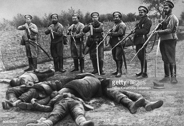 Cossack soldiers of Russia and the Ukraine with the bodies of their adversaries circa 1920