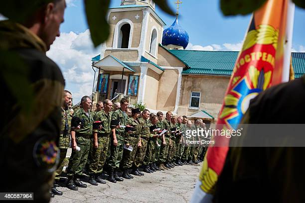 Cossacks army recruits fighting on the side of selfproclaimed Lugansk People's Republic are swornin on the frontline July 11 2015 in Pervomaisk...