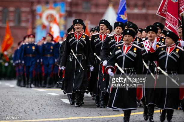 Cossacks march along Red Square during the Victory Day military parade in Moscow on May 9, 2021. - Russia celebrates the 76th anniversary of the...