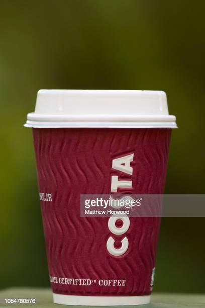 Costa Coffee cup with a blurred green background on October 1 2018 in Cardiff United Kingdom Costa Coffee owner Whitbread which also owns the Premier...