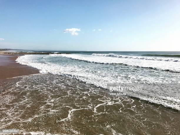 costa da caparica beach - moura stock photos and pictures