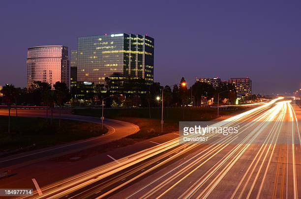 costa mesa and the 405 freeway at dusk - costa mesa stock photos and pictures
