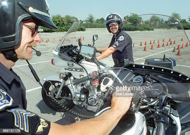 Costa Mesa–KODAK–Costa Mesa police department Sgt Karl Schuler and senior motor training officer Angelo Morgan at a training facility across the...