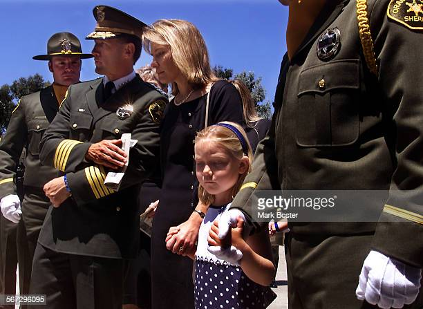Costa Mesa––Orange County Sheriff Michael Caronaescorted Kathy Parsons and her daughter Kelsey 6 at the funeral for her husband Steven Edward Parsons...