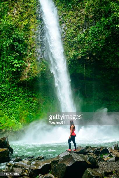 Costa Rica, Arenal Volcano National Park, Woman at the waterfall of La Fortuna