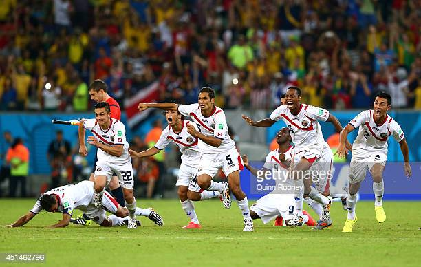 Costa Rica celebrate after defeating Greece in a penalty shootout during the 2014 FIFA World Cup Brazil Round of 16 match between Costa Rica and...