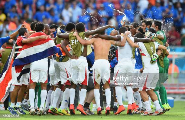 Costa Rica celebrate defeating Italy 1-0 during the 2014 FIFA World Cup Brazil Group D match between Italy and Costa Rica at Arena Pernambuco on June...