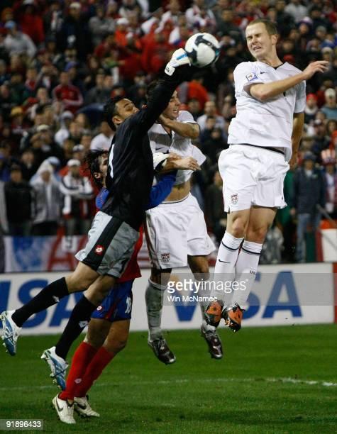 Costa Rica goalie Keilor Navas battles Oguchi Onyewu of the U.S. During their match in the FIFA 2010 World Cup Qualifier at RFK stadium on October...