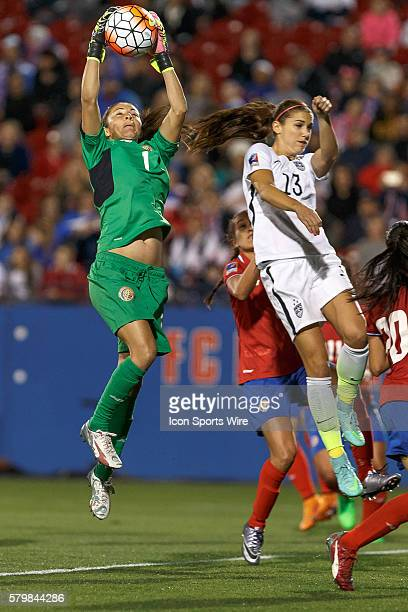 Costa Rica Goalkeeper Dinnia Diaz leaps to make a stop on a corner kick in front of United States Forward Alex Morgan during the Women's Olympic...