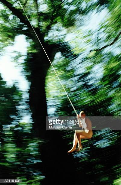 Costa Rica, Monteverde Cloud Forest, woman swinging on rope