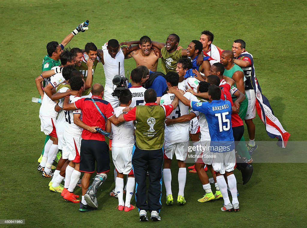 Costa Rica players huddle on the field and celebrate the 1-0 victory in the 2014 FIFA World Cup Brazil Group D match between Italy and Costa Rica at Arena Pernambuco on June 20, 2014 in Recife, Brazil.