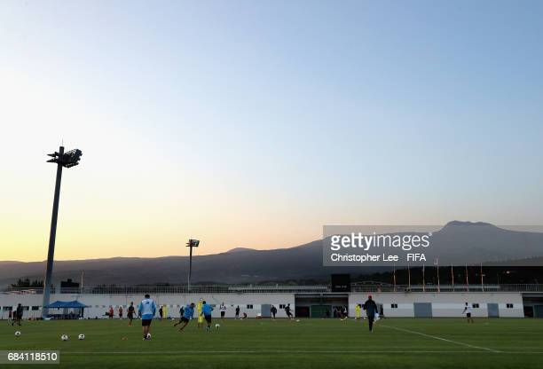 Costa Rica players in action as the sun down down with the Hallasan Mountain in the background training Session at Kang Chang Hak Stadium on May 17...