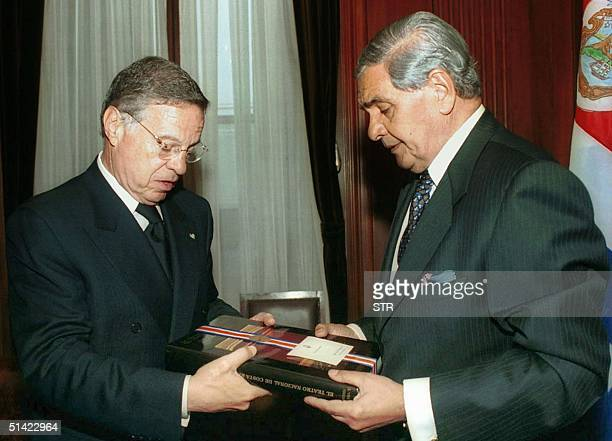 Costa Rica President, Miguel Angel Rodriguez exchanges presents with President of the Argentinian Supreme Court, Julio Nazareno 16 August 2001 in...