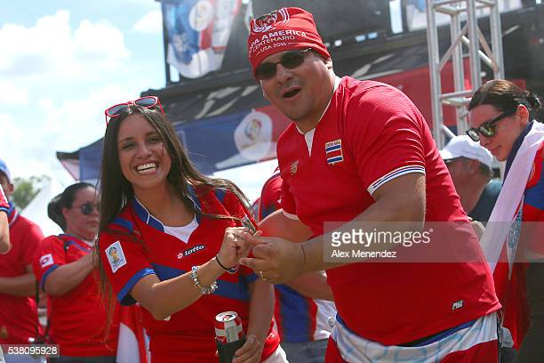 Costa Rica soccer fans dance in the fan zone during the 2016 Copa America Centenario Group A match between Costa Rica and Paraguay at Camping World...